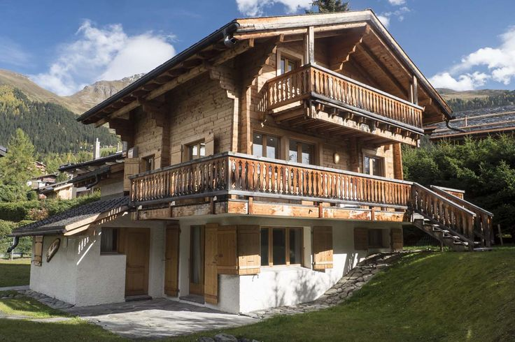 This chalet gives the appearance of being sand blasted - the balconies also show nice symmetry given one is concrete and one is wood in base construction.