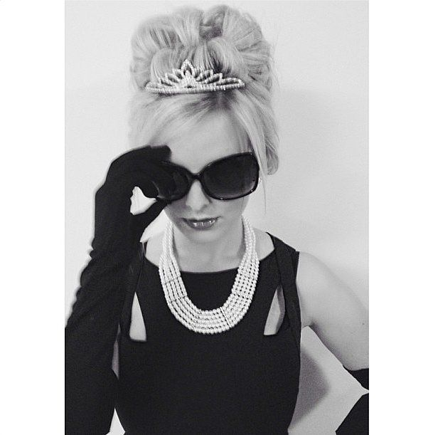 Fashionable Halloween costume inspiration: Dress as Holly Golightly From Breakfast at Tiffany's by wearing a black dress with pearls, gloves, oversized sunglasses and a tiara.