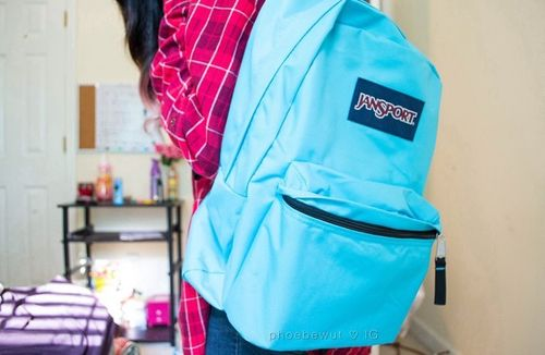 neon blue Jansport backpack