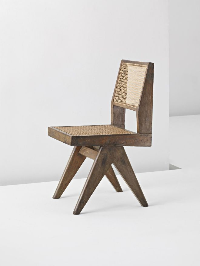 This Pierre Jeanneret design has a simple form with raw wooden base and woven seat and back.