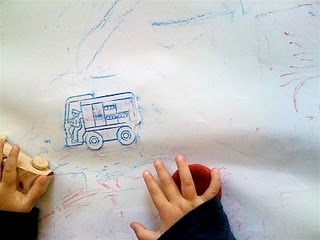 Picture hunting {tape stencils to table, cover with big sheet of paper, let children loose with crayons}