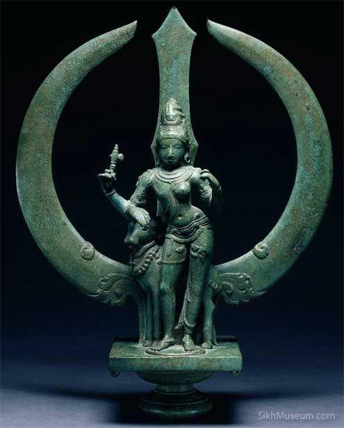 Trident with Shiva as Ardhanari (Half-Woman) ca. 1050, Chola dynasty, South India. Daniel Wamba on Tumblr.