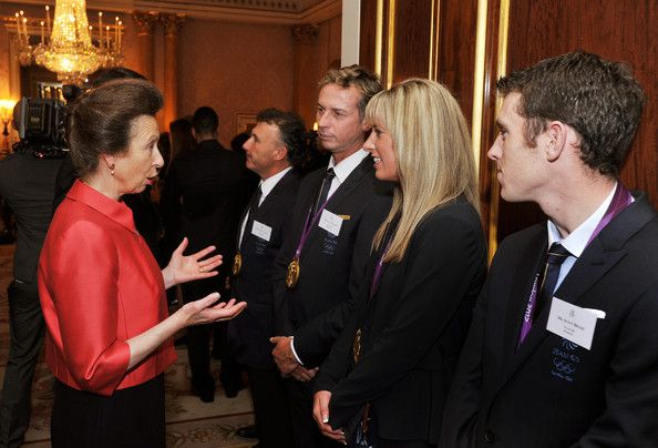 Princess Anne, Princess Royal (L) talks to (L-R) Carl Hester, Charlotte Dujardin and Scott Brash during a reception held for Team GB Olympic and Paralympic London 2012 medalists at Buckingham Palace