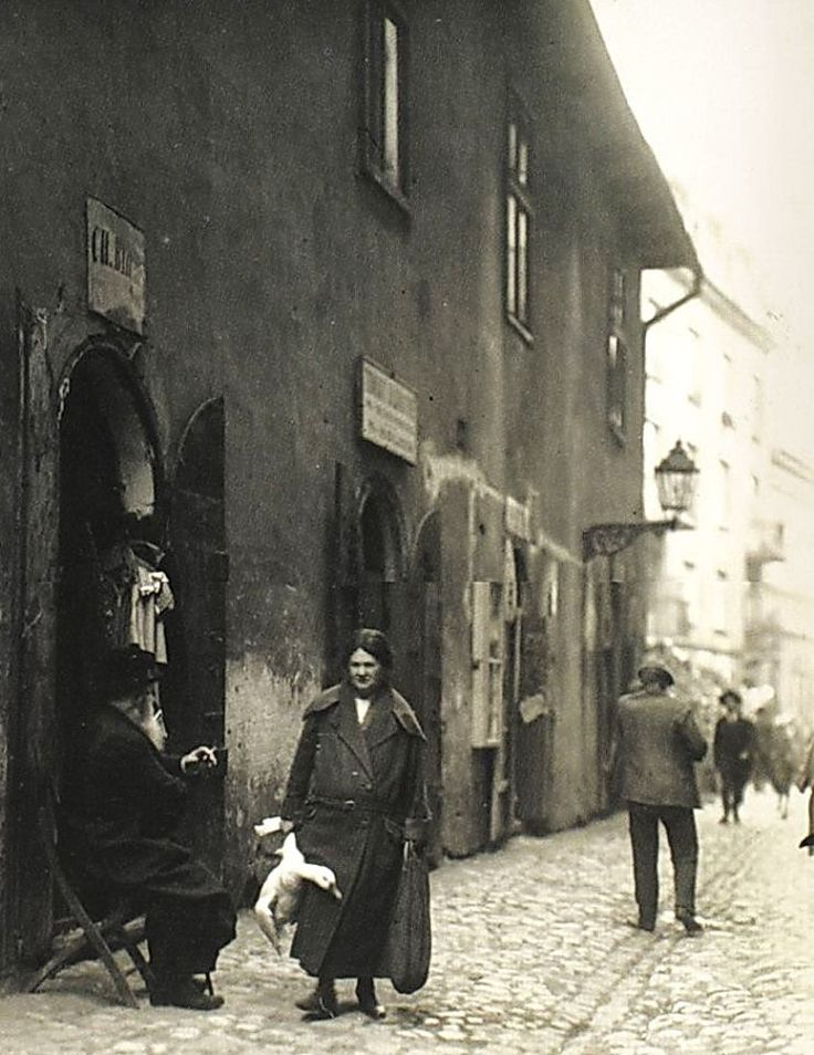 """""""Woman with the live goose on Meiselsa Street on her way back from the market""""  Krakow - Kazimierz, 1930s"""