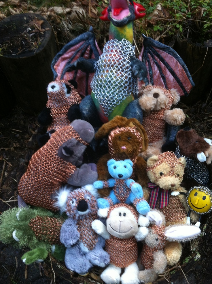 Basket full of fun!  Chain mailled bears, bunnies, a dragon, hippo, smilie face, froggy, reindeer, koala and panda.