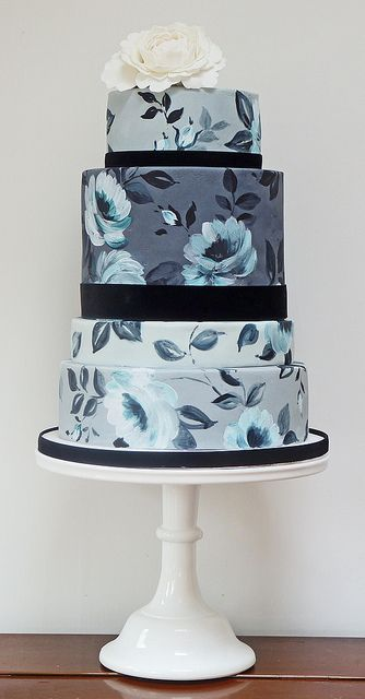 Wedding cake in shades of gray and blue. Floral.