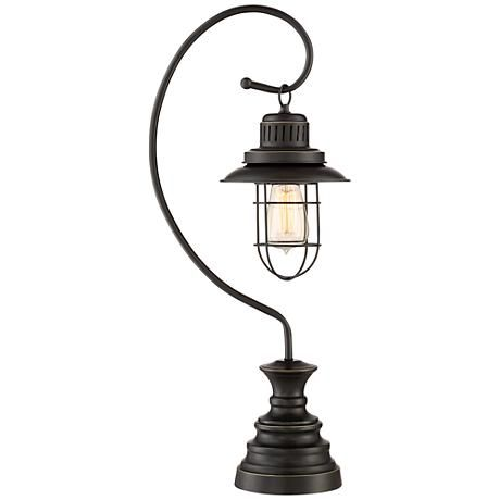 An industrial style desk lamp with a deep oil rubbed bronze finish open