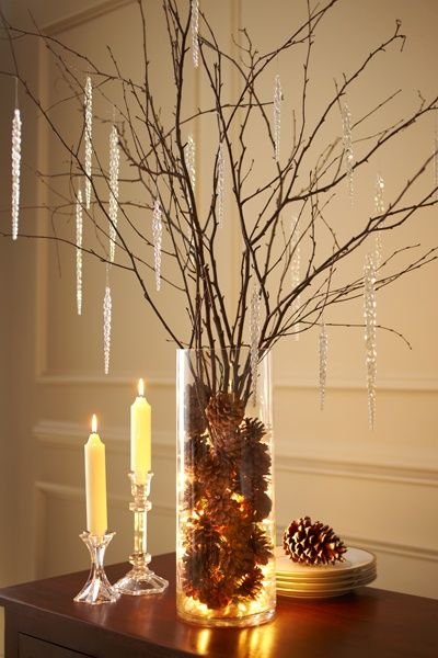 Branches, vase,  pinecones and battery operated lights.