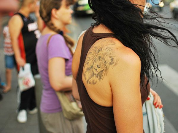 Lady With Lion Tattoo