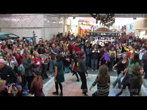 """""""Christmas music flash mob featuring a new original version of Merrily On High and bringing together 150+ choir singers, Irish Dancers, bell ringers and over 1000 onlookers."""""""
