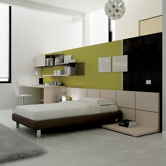 Il sistema di pareti attrezzate con boiserie tile valorizza lo spazio dedicato al riposo si - Pareti dipinte per camerette ...
