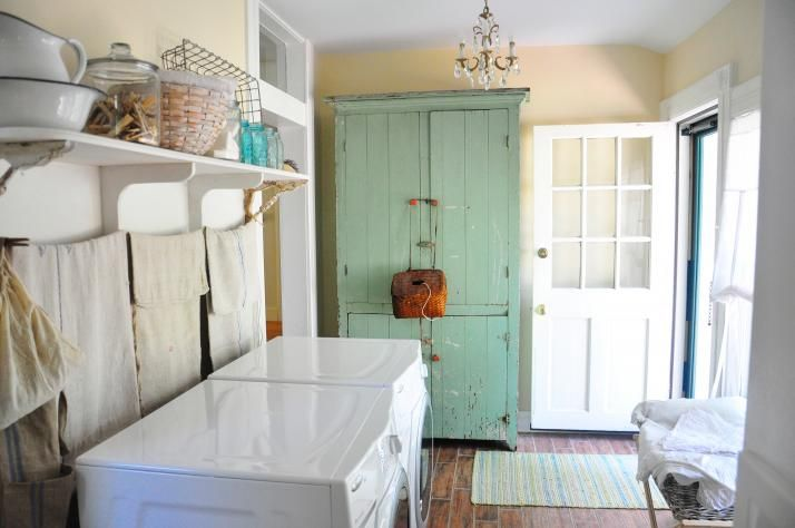 Circa 1865 Missouri Farmhouse Refreshed Laundry Room - everyone should have a chandelier in their laundry room!