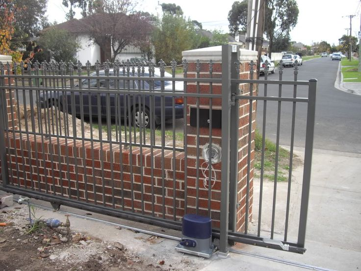 26 best brick fence images on pinterest brick fence for Brick and wrought iron fence designs