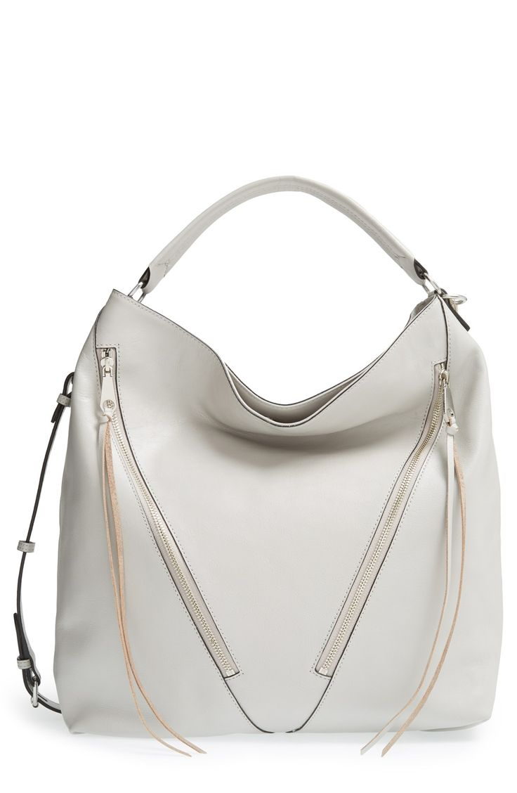 The asymmetrical zip pockets give this leather Rebecca Minkoff hobo bag a bit of a moto edge.