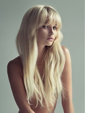 Loads of volume with platinum colour l Stunning long blonde straight coloured womens hairstyle.