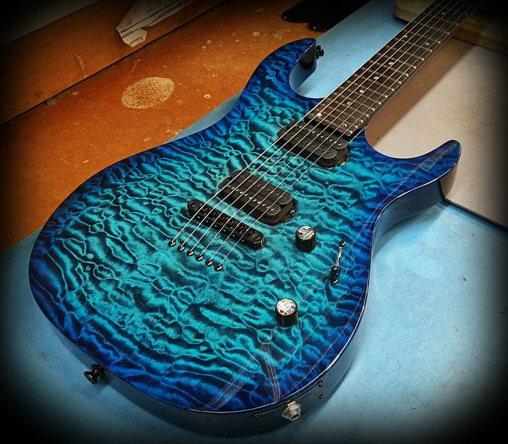 Carvin dc in deep aqua burst over a quilted maple top
