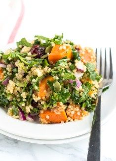 A deliciously sweet and zesty Roasted Sweet Potato Quinoa Salad recipe all dressed up in a zesty lime vinaigrette. Fluffy white quinoa dressed in a zesty lime dressing with roasted sweet potato, cranberries, and kale made into a pretty fantastic and easy-to-make salad.   And because sweet potatoes are tasting extra delicious this time of year. Yes – they are delicious every day of the year but there's just something so warm and cozy about carbs in January!    ABOUT THIS SWEET POTATO QUINOA…