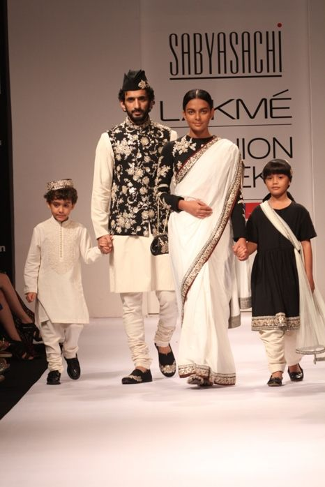 Sabyasachi had said during the Marie Claire 50 Questions he will be showing kidswear that doesnt make them look like 20 something bimbettes. He wasnt kidding. I love how clean and polished the whole family looks.