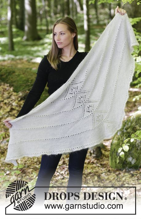 Knitted shawl with lace pattern.  The piece is worked in DROPS Alpaca and DROPS Kid-Silk. Free pattern by DROPS Design.