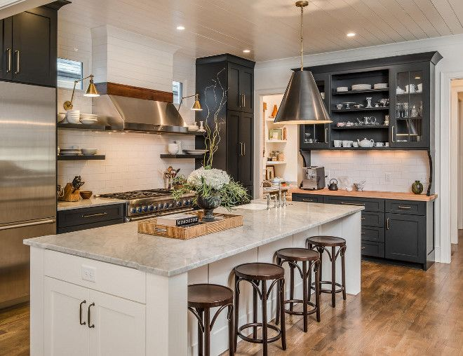 Interior Design Idea Kitchen with black perimeter cabinets and white white island and shiplap backsplash and shiplap ceiling.