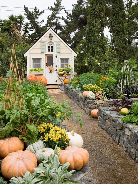 Fall garden ~ love the stone walls and garden house