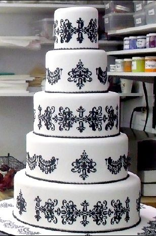 black lace piping on white fondant... but ivory instead of white.
