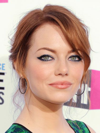 """""""Don't worry about every little strand,"""" says hairstylist Mara Roszak of Andy Lecompte Salon in Los Angeles, who created this look for Emma Stone. """"Let some of the layers fall out and frame the face and the back of the neck."""" #wedding #hair"""