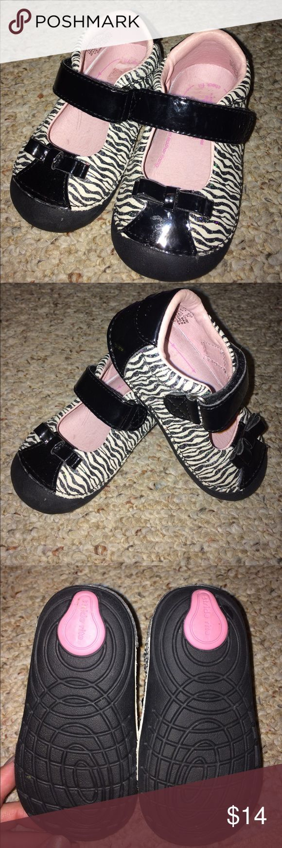 Stride Rite Black and White zebra toddler shoe; 5 Oh so adorable! These Zebra shoes in black and white, sparkle with glitter! Velcro closure across the top. Leather upper.  Bought from another posher but too small for my little girl's feet 😖 A great walking shoe with support and skid free soles! So sad to part with them. Stride Rite Shoes Baby & Walker