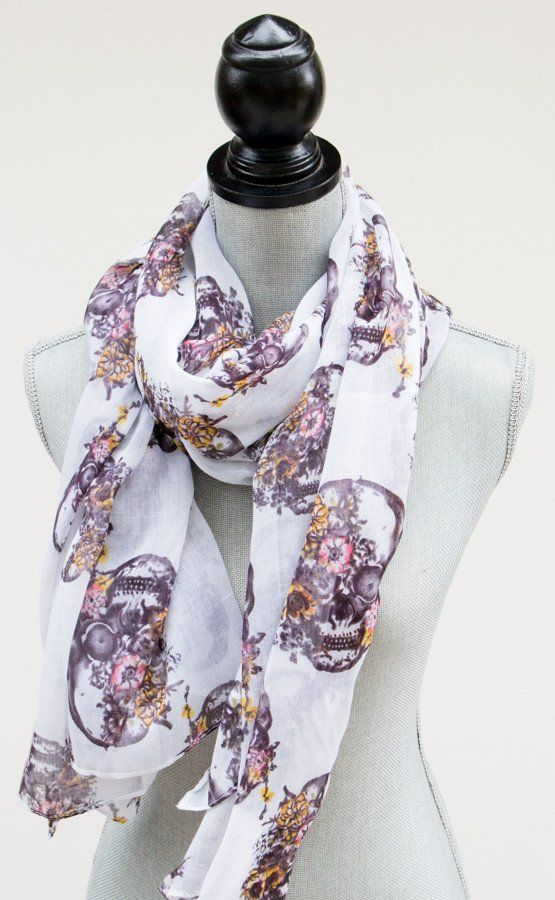 "Accessorize with our hip floral skull scarf! This amazing high quality scarf is perfect to wrap around your pretty little self on those chilly days! Details: - Measures 71"" long by 40"" wide......perfe"