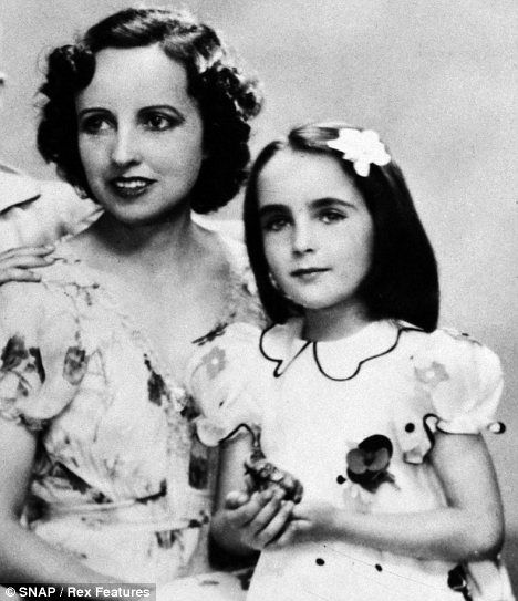 Elizabeth Taylor, 5, poses with her mother Sara, 1937.