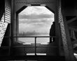 n this Dec. 22, 1936, Works Progress Administration photo provided by the New York City Municipal Archives, a man looks at the Hudson River from the New York tower of the George Washington Bridge.