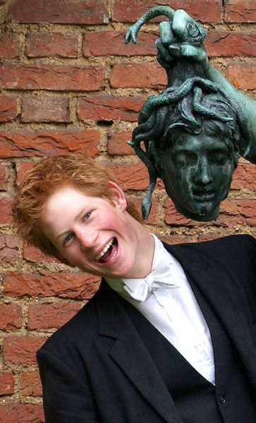 Prince Harry stands next to a bronze statue of Perseus holding the head of Medusa, one of the three Gorgon sisters, at Eton College in 2003. The 18-year-old prince was finishing his studies at Eton College.
