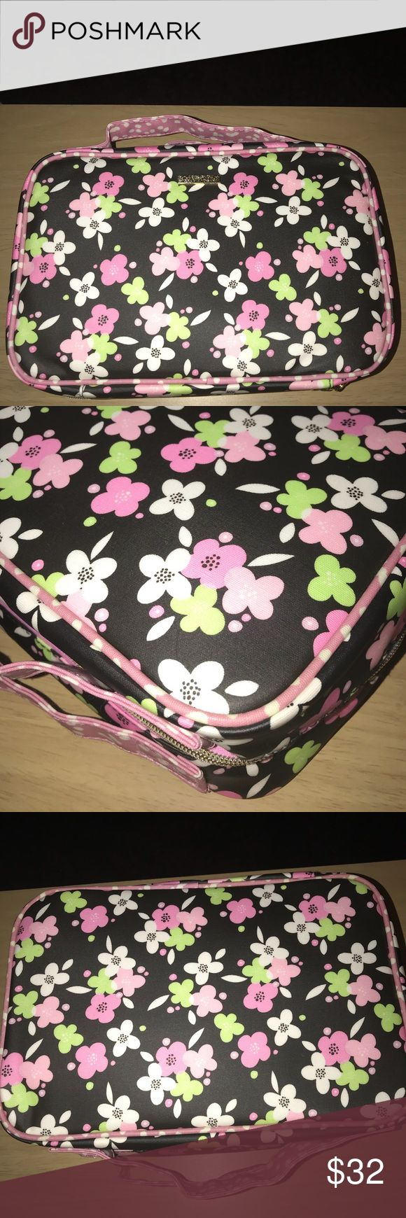 "New floral cosmetic bag set of three New without tags floral cosmetic bag set of three.  By Sophia Joy.  Pretty in pink floral cosmetics case with two top handles and zipper closure all around.  Gold hardware.  Two small cosmetic cases inside still attached to bag with plastic tag.  Large case is 11"" wide and stands 8"".  4"" deep.  Inside cases are about 9"" wide and stands 4"".  2"" deep.  One is a clear pouch h the other is the same pink floral design both with top zipper.  No flaws on these…"