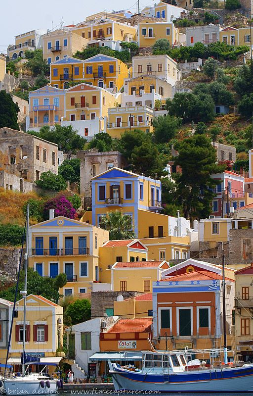 The colourful houses of Symi island, all piled up on top of one another, Dodecanese in Greece