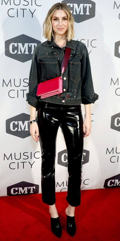 Whitney Port showed us how chic a pair of shiny leather pants can be with an embellished denim jacket and a multi-color bag.