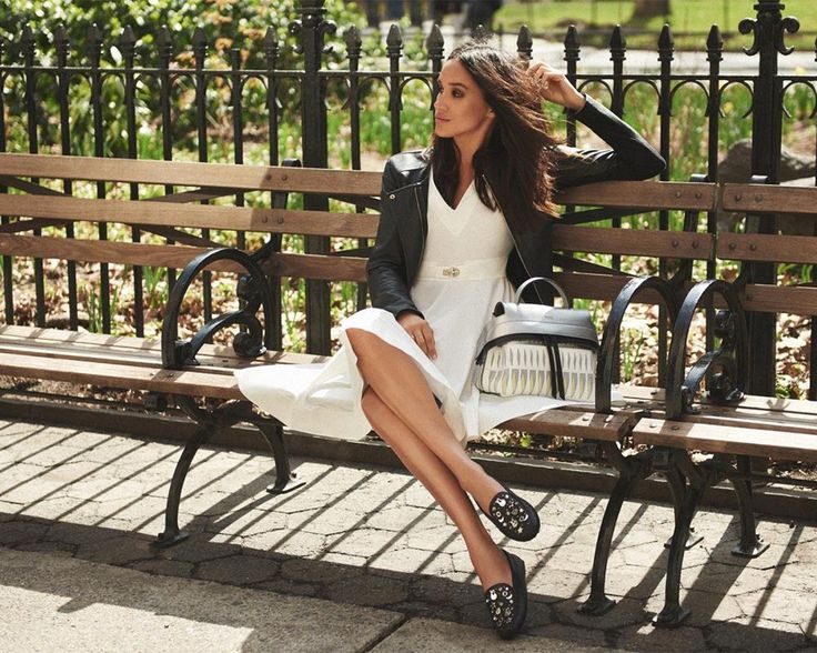 Beautiful actress Meghan Markle compliments her white Fay dress with a chic biker jacket.