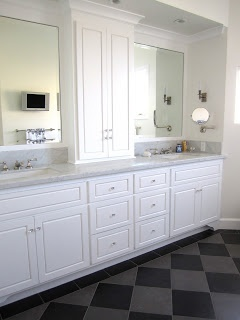 Long Bath vanity with framed mirrors & storage in the center