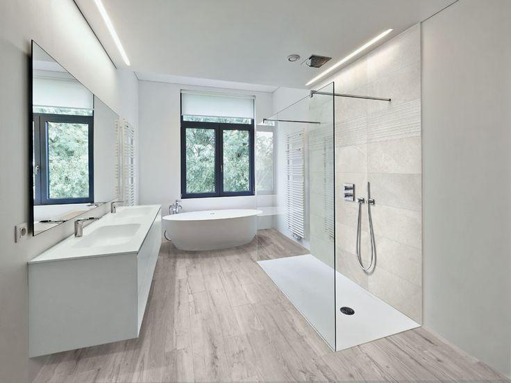 This modern bathroom has a wood look porcelain flo…