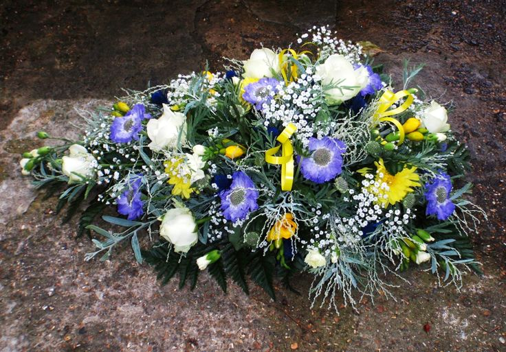 single ended spray with blue scabiosa, white roses, yellow freesia, gypsophila and acacia italiana foliage.