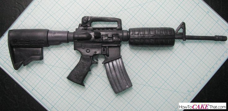 Free step-by-step photo tutorial on how to make a realistic AR-15 rifle. Perfect topper for a gun case cake. Would be a great birthday cake idea for anyone serving in the military or for a gun enthusiast. :)