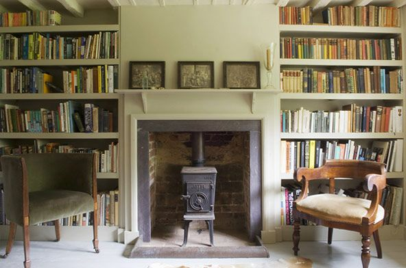 SHOOTFACTORY - WOOD BURNER, OPEN BOOK SHEVLES IN ALCOVES + MISS MATCHED ANTIQUES CHAIRS. shootfactory location agency www.shootfactory.co.uk