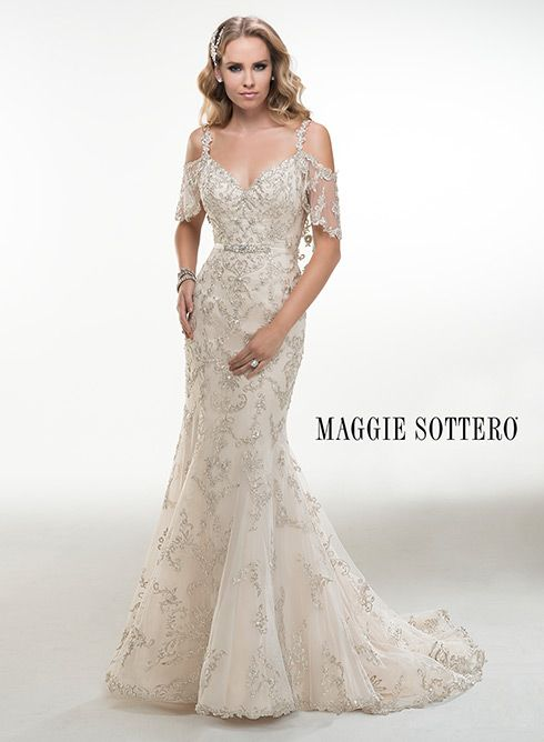 Illusion cold shoulder flutter sleeves adorn this dazzling Swarovski crystal embroidered A-line wedding dress, Maurine, by Maggie Sottero.