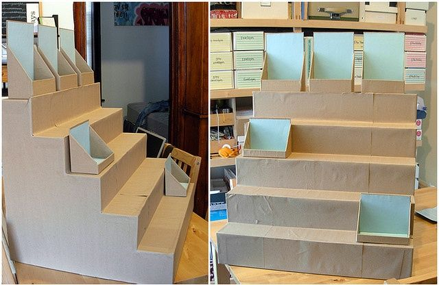 Cardboard box built up display. Would be really cute to cover in newspaper, or paper mâché.