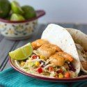 http://www.cookingonthefrontburners.com/2013/06/shrimp-tacos-with-spicy-coleslaw.html
