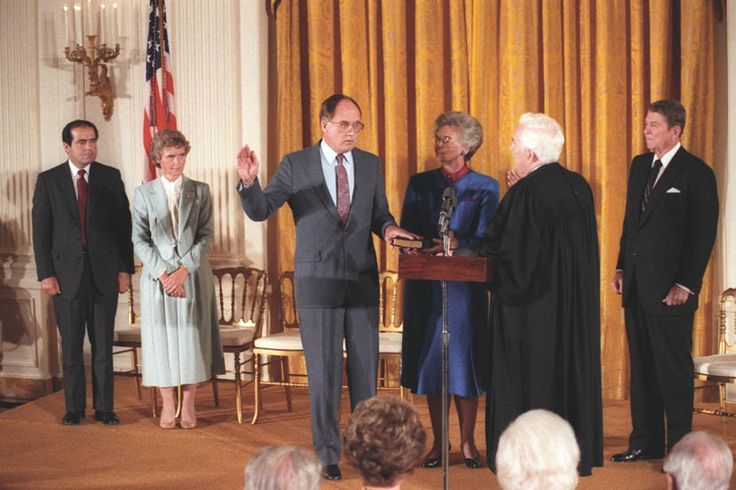William Rehnquist being sworn in as Chief Justice by Warren Burger in the East Room. From left to right:AntoninScalia, MaureenScalia, Wil...