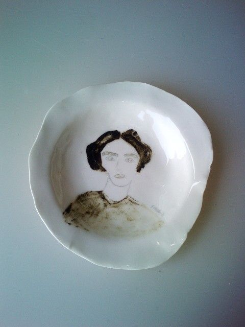 Porcelain plate with handpainted girl