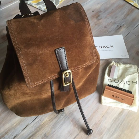 Coach suede mini backpack *FINAL SALE* ****Shutting down site this week all prices have been lowered in my closet grab before its off site thank you ladies for the likes and shares its been a pleasure! ****** Coach suede mini backpack bought in coach store bag came with a water stain as pictured in pics does not effect bag. Comes with coach cleaning brush and cleaning eraser. In excellent condition besides water stain. **No Trades* Coach Bags Mini Bags