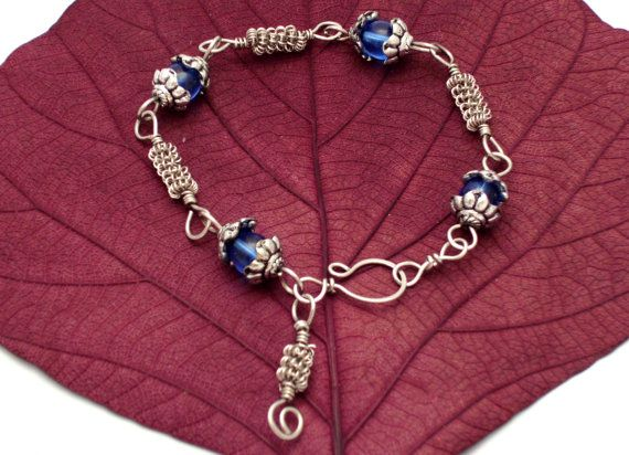 Silver and blue #bracelet from surgical steel by #evatelier #Etsy  https://www.etsy.com/listing/160173836/silver-and-blue-bracelet-surgical-steel?ref=shop_home_active_1
