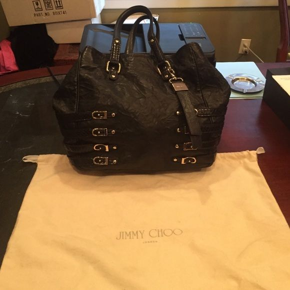 Gorgeous Jimmy Choo bag Beautiful Authentic Jimmy Choo bag gold adornments on the bag . Very soft  leather excellent condition comes with sleeper bag the dimensions are 14x14 this is a very big shopper bag bought in Neman Marcus for $2100 Jimmy Choo Bags