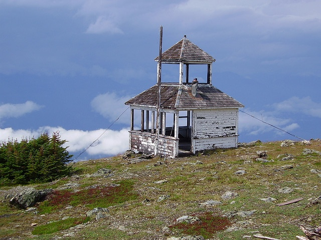 abandoned fire tower on a mountain overlooking McBride, B.C., Canada